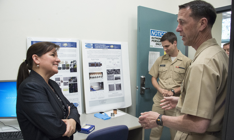 Chief of Naval Operations (CNO) Adm. John M. Richardson is briefed by NPS Professor Claudia Luhrs at NPS' Center for Materials Research, June 16. Richardson toured the campus and met with NPS faculty, staff and students during a visit to campus for the university's Spring Quarter Graduation ceremony.