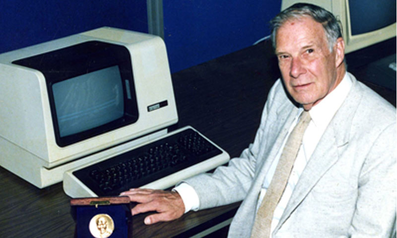Hamming is pictured with the IEEE Hamming Medal in an NPS laboratory following the award's establishment in 1986. In addition to being its first recipient, Hamming was presented with several other honors and awards, including ACM's prestigious Turing Award, and was elected to the National Academy of Engineering.