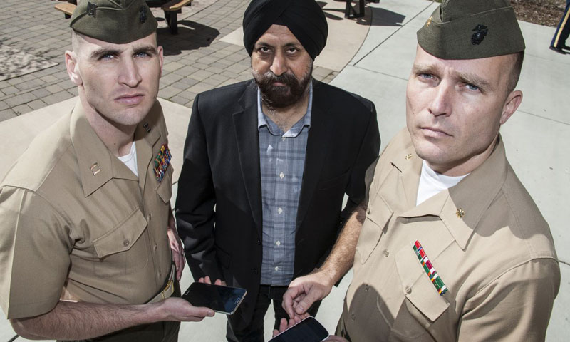 Naval Postgraduate School (NPS) professor Gurminder Singh has been working with U.S. Marine Corps Maj. Ryan Barnes, right, and Capt. Buck Bradley, left, on a NPS Studies Program designed to create a handheld application that the USMC Installation and Logistics Command hopes will simplify and facilitate the sending of mission critical reports under stressful conditions.