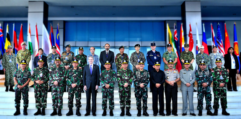 Senior officials and representatives from several southeast Asia nations gather for a group photo during the ASEAN Defense Ministers Meeting Counter Terrorism Exercise in September of 2013.