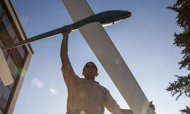 Naval Postgraduate School student, Mexican Navy Lt. Nahum Camacho, shows off the Tactical Long Endurance Unmanned Air System (TaLEUAS) aircraft.