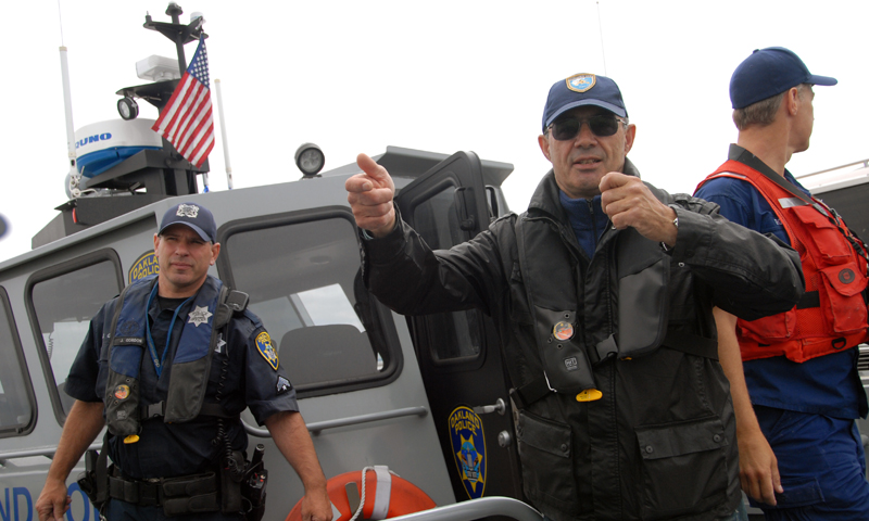 Naval Postgraduate School Associate Professor Alex Bordetsky, center, aboard an Oakland Police Department vessel in the San Francisco Bay, June 11. Bordetsky is the lead researcher in a globe-spanning experiment designed to detect and eliminate a simulated radiological device aboard a hostile vessel.