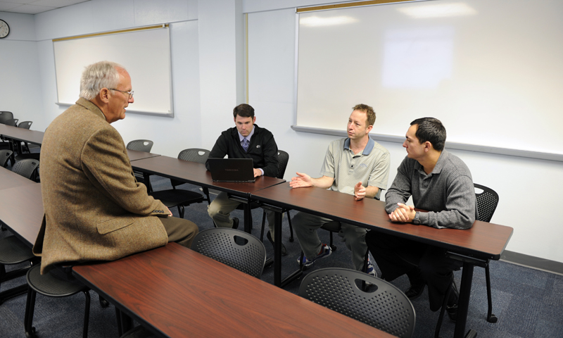 Students in the Defense Budget and Financial Management Policy class discuss with Professor Douglas Brook possible ways to reduce federal debt, a conversation sparked by a debt-reduction simulation the class worked through.
