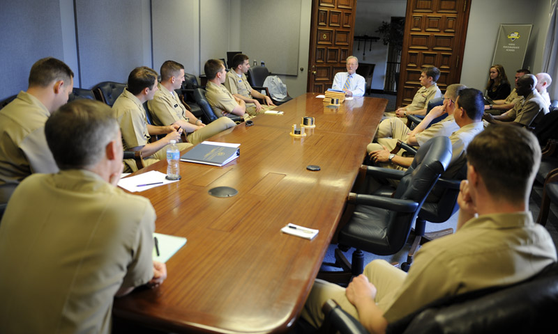 Chief of Naval Operations Strategic Studies Group (CNO SSG) Director retired Adm. James Hogg, center, addresses the NPS contingent of Director Fellows for CNO SSG XXXII on the day of their final selection for the fellowship.