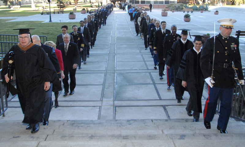 Graduates cross Spruance Plaza during the graduation procession for the Fall Quarter commencement ceremonies, Dec. 16. A total of 365 students earned advanced degrees during this quarter's ceremony.