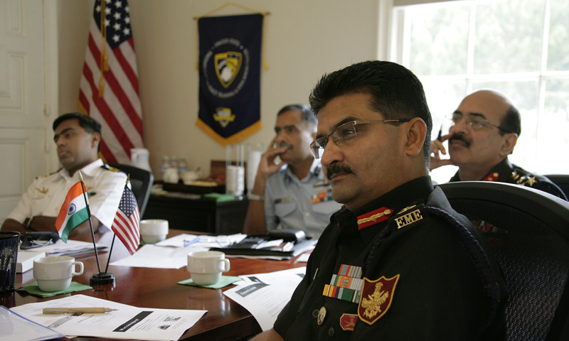 A delegation from the India Integrated Defence Staff listen to NPS Prof. Moshe Kress explain the philosophies of quantitative decision making models and practical applications of operations research tools and techniques during a campus visit, Aug. 30. Pictured, left to right, are Indian Navy Cmdr. Y. Phanindra, Air Vice Marshal M. Bahadur, Brig Sunil Aneja and Col. Rajesh Puri. The sharing of subject-matter expertise is just one small piece of an expanding partnership between NPS and its peer Indian institutions.