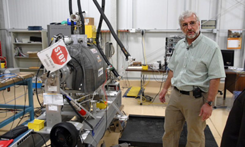NPS Research Associate and Professor Richard Swent stands with the Mark I as the team prepares to test the structure. Mark I is part of the free electron laser laboratory's newest additions, and one that faculty and students are hoping will help optimize the FEL's capabilities.
