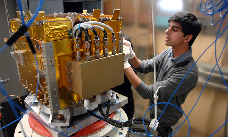 Space Systems Engineering student Vidur Kaushish performs final testing procedures on the Naval Postgraduate School designed and built CubeSat axillary payload platform. The launcher will send several CubeSats into Low Earth Orbit when it is launched in August of this year.