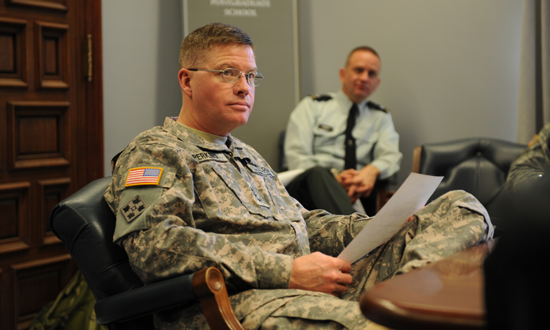 Commanding General, U.S. Army Combined Arms Center, Lt. Gen. David Perkins, listens to National Security Affairs Chair, Dr. Dan Moran, during a briefing on different programs offered at the Naval Postgraduate School, Jan. 10.
