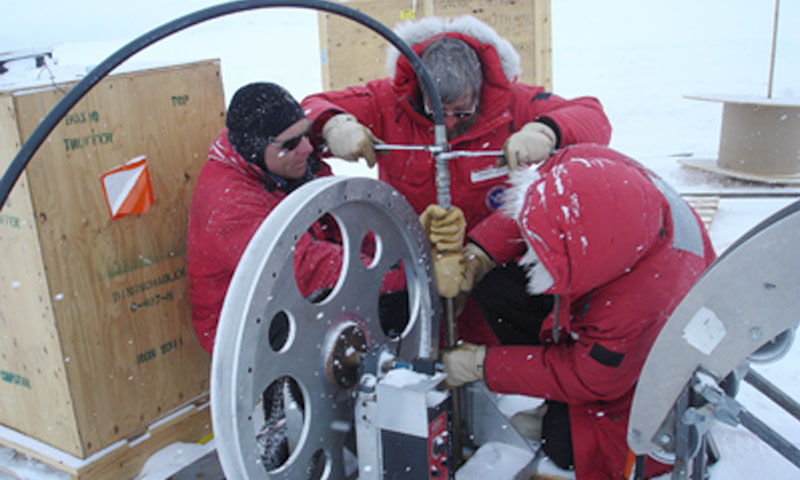 NPS Research Professor of Oceanography Tim Stanton, right, helps fellow researchers test the hot-water drill that will be used to create a tunnel for the ocean profiler. The researchers have made several trips to Antarctica to test the equipment in preparation for their current research trip, which will run from the end of Nov. through the end of Jan.