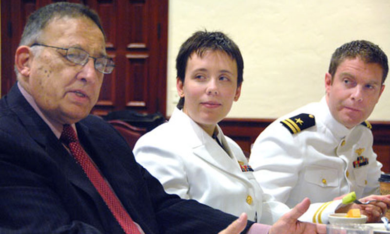 A tradition during every quarter's graduation is the Speaker's Breakfast, where select students are afforded the opportunity to engage with the commencement speaker in a more informal setting. Here, from left to right, retired Rear Adm. and EADS North America senior executive David R. Oliver, Jr., discusses the qualities of leadership as students Lts. Elaine Reid and Nathan Matson listen in.