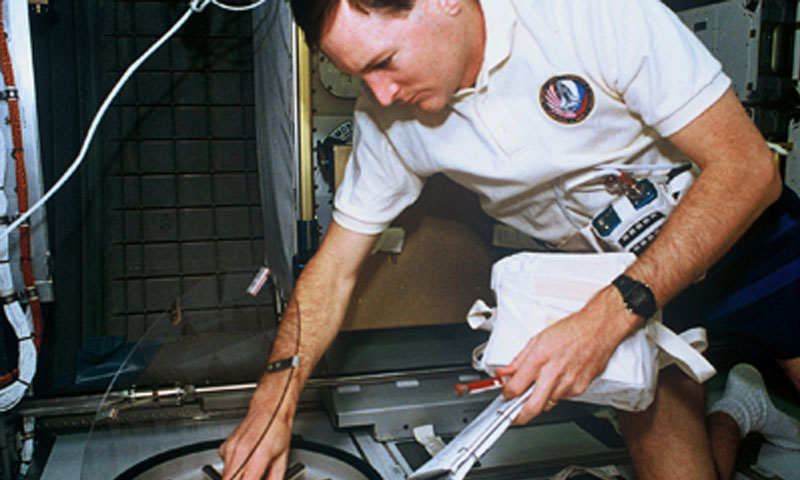Former NPS Astronaut and retired Navy pilot Ken Reightler, shown here preparing for his duties as Commander of STS-60, now serves as Vice President of Engineering Services at ATK Aerospace Systems. He and his team work with NASA to develop new capabilities for space exploration.