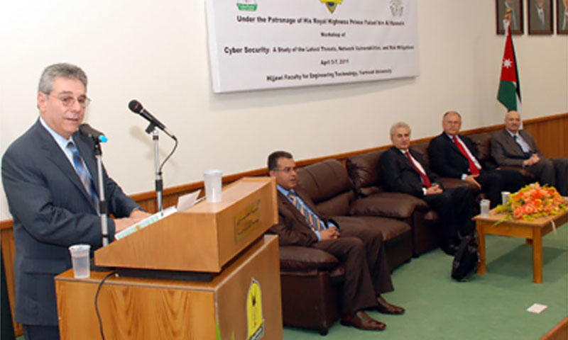 NPS Executive Vice President and Provost Leonard Ferrari, left, opens a cybersecurity workshop at Yarmouk University in Jordan. Sitting, left to right, are Dr. Muwaffaq Al-Omoush, Dean of Engineering at Yarmouk University; Dr. Wajih M. Oweis, Jordanian Minister of Higher Education; Dr. Abu Orabi, President of Yarmouk University and Mr. Larry Mandell, Deputy Chief of Mission for the U.S. Embassy in Jordan.