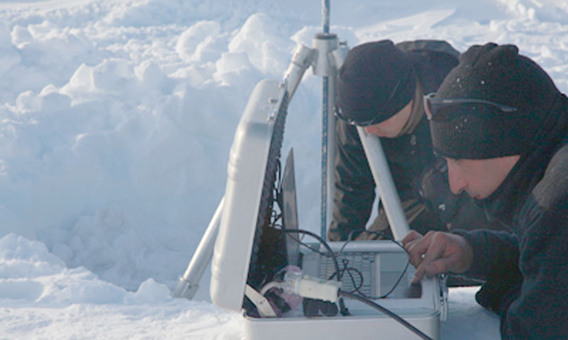 NPS students from left to right, Lt. George Suh and Lt. Brandon Schmidt scan an ice keel using sonar during their ten-day research trip to the Arctic. The trip, sponsored by the Office of Naval Research, was part of the Navy's Ice Exercise 2011.