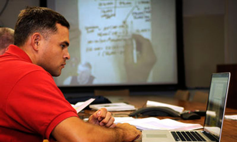 Lt. Erik Molina reviews his notes on his computer for his Executive Master of Business Administration (EMBA) course.