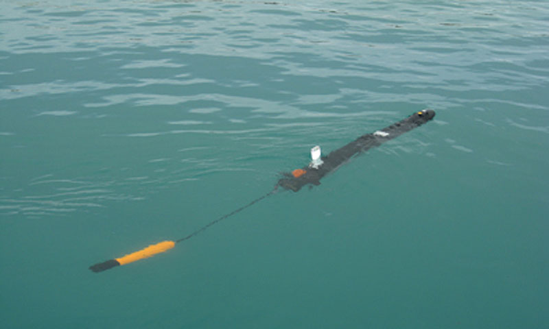 An Ocean Saver Iver2-580-EP UUV tows a safety device during a littoral field studies experiment off Miami, Fla. U.S. Navy photo / Released.