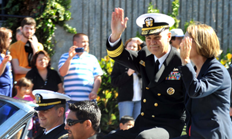 Vice Adm. Richard W. Hunt, left, commander of U.S. 3rd Fleet, and Mrs. Hunt, wave to the crowd as part of the Columbus Day Celebration Parade during San Francisco Fleet Week 2010. Hunt served as Grand Marshal of the parade.