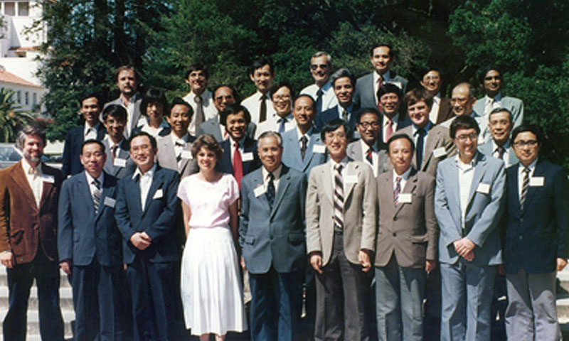 NPS Distinguished Professor C.P. Chang with participants of the Second U.S.-People's Republic of China Workshop on Cooperation in Monsoon Research, held at the Naval Postgraduate School in June 1985. The U.S. scientists include, front row: far left, John Young of the University of Wisconsin, far left; Michio Yanai of the University of California at Los Angeles, third from left; Chang, sixth from left; Lance Bosart of the State University of New York at Albany, seventh from left. Second row: William Lau of NPS, now with NASA's Goddard Space Flight Center, third from left; Peter Webster of the Massachusetts Institute of Technology, now at Georgia Tech, sixth from lef); Takio Murakami of the University of Hawaii, seventh from left. Third row: Melinda Peng of NPS, now with Naval Research Laboratory (NRL) Marine Meteorology, second from left; C.S. Liu of NPS, now with NRL Marine Meteorology, fourth from left; Man-Kin Mak of the University of Illinois, fifth from left; Bill Kuo of the National Center for Atmospheric Research, 6th from left. Fourth row: second from left; Russ Elsberry of NPS, fourth from left; T. Krishnamurti of Florida State University, far right. U.S. government representatives include Pam Stephens of the National Science Foundation, first row, fourth from left; and the representatives from the National Oceanic and Atmospheric Administration, fourth row, far left; and the State Department, fourth row, fifth from left, and third row, far right. The Chinese delegation was led by Shiyan Tao, Director of Atmospheric Physics, Chinese Academy of Sciences, front row center, and Yihui Ding of the National Climate Center, China Meteorological Administration, first row, far right.