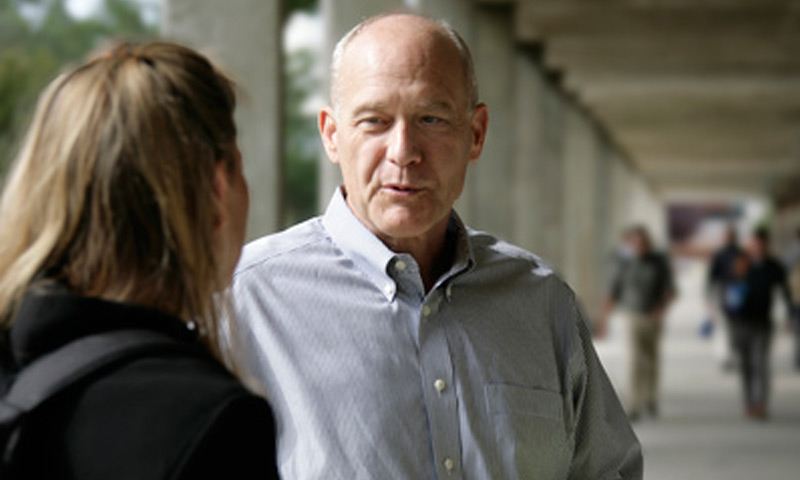 Retired Rear Adm. Andy Singer speaks with student Lt. Beth Jasper outside Root Hall on the NPS campus. Recognizing that intelligence is a critical area of opportunity over adversaries and to maintaining dominance in the information realm, Singer guides intel educational efforts as NPS' Adm. Bobby Inman Intelligence Chair, as well as Director of the Information Dominance Center of Excellence.
