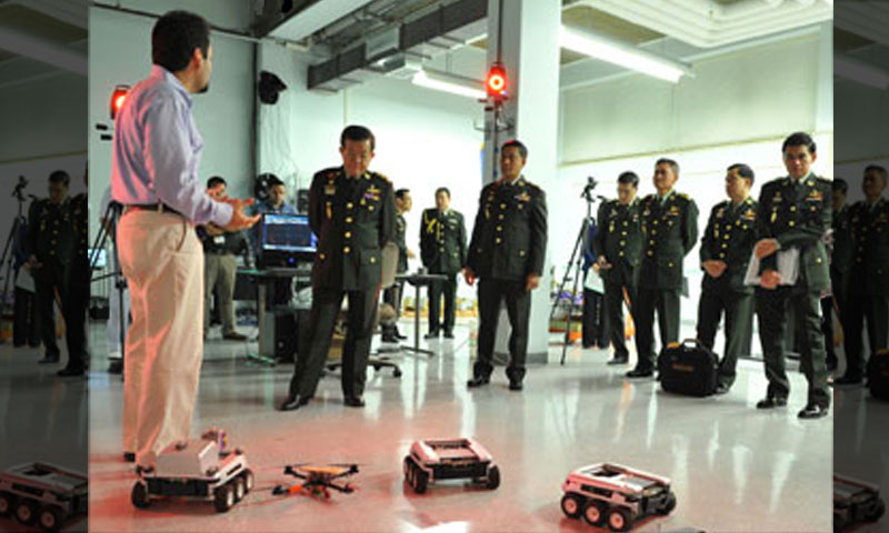 General Apichart Penkitti, Permanent Secretary of Defence of Thailand, tours the Autonomous Systems labs in Halligan Hall following his induction into the NPS Hall of Fame on July 30.