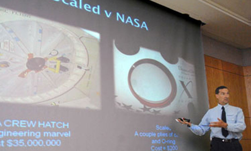SpaceShipOne pilot Brian Binnie breaks down the cost differences between a NASA shuttle flight and a flight aboard a sub orbital craft built by Scaled Composites.