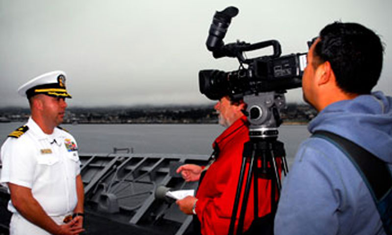 Cmdr. Joey Frantzen, Executive Officer aboard the USS Mobile Bay, explains the features of the ship for a segment of NPS Pentagon Channel program, Inside NPS.