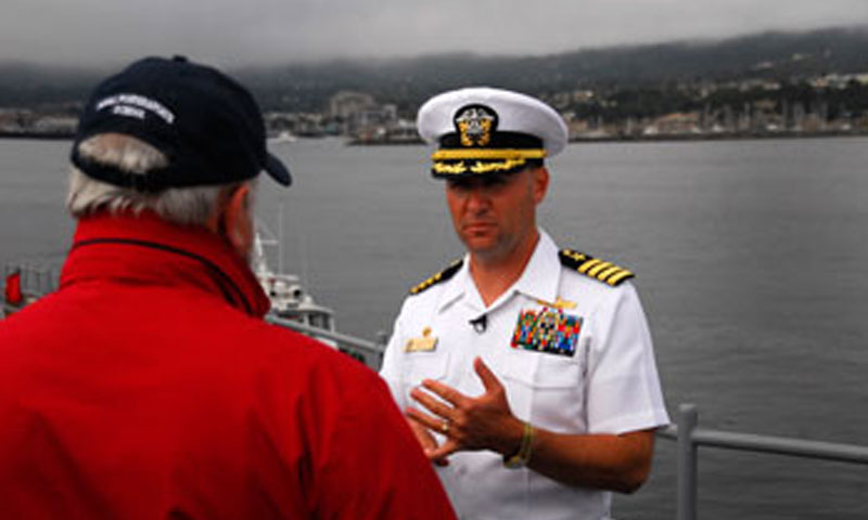 Capt. Jim Housinger of the USS Mobile Bay explains the features and responsibilities of the ship during a rare port visit to the Monterey Bay. The Ticonderoga class cruiser features the Aegis Combat System, originally pioneered by NPS Hall of Fame member retired Rear Adm.