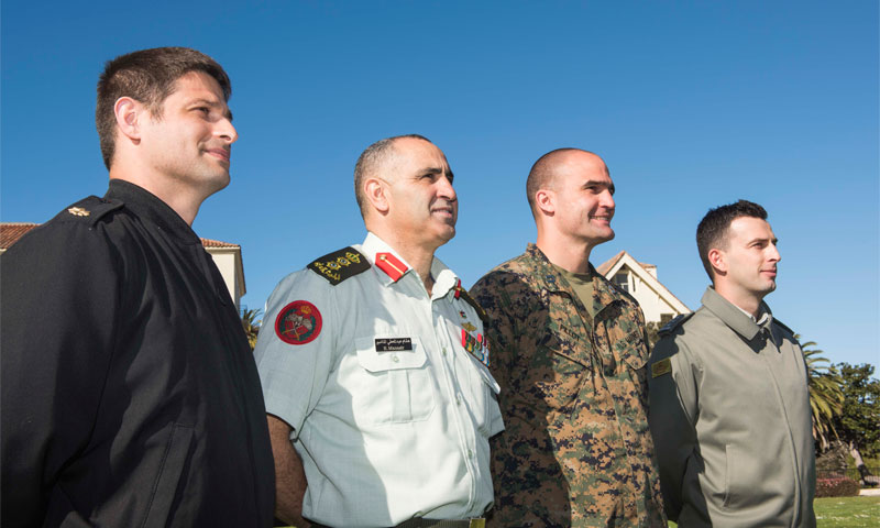 Four December 2017 graduates, U.S. Army Maj. Pete Wilcox, Jordanian Army Col. Hisham A. Al Manasir, U.S. Marine Corps Capt. Beau Pillot, and Albanian Army Capt. Bleard Vucaj, from left to right, offered unique, detailed analyses of the Islamic State through their graduate theses, providing a deeper understanding of the world's most infamous terrorist organization.