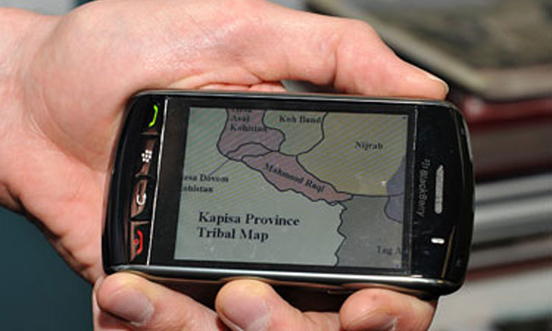 "A BlackBerry running the ""MobiAFG"" application displays a tribal map of Kapisa Province in Afghanistan."