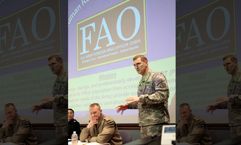 """Lt. Col. David Brigham explains the role of the Army Foreign Area Officer during the 4th Annual FAO Conference, a student-run event held at NPS. Lt. Col. Brigham served on the warrior panel, answering questions and concerns by current and future FAOS about their many roles in the service. FAOs gathered from around the world to share their insight and expertise on what it takes to """"bridge the gap"""" between their roles as a warrior, scholar and diplomat both here and abroad."""