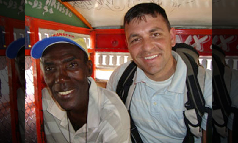 With his knowledge of the French language, Capt. Brandon Newell, right, was able to establish some direct communication with local Haitians. Here, a man on board a 'tap-tap,' or taxi, happily poses for a photo.