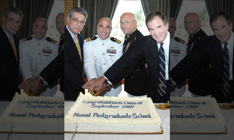 Following the ceremony, the graduates and their family members gathered in the Barbara McNitt Ballroom for the cutting of the class cake. Joining President Daniel Oliver, Provost Leonard Ferrari and Conant for the honors was the recipient of four top awards for academic achievement and excellence in engineering, Lt. Cmdr. Jon Letourneau.