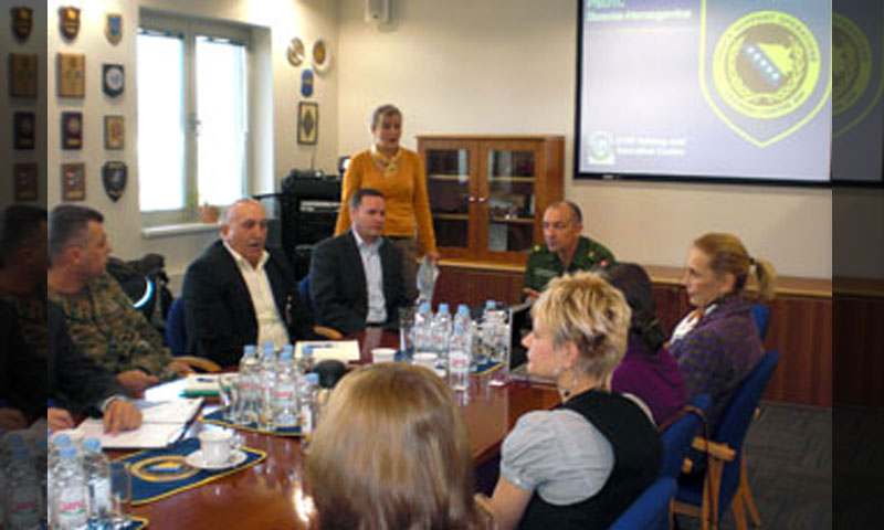 Brig. Gen. Michael Lollesgaard, center, then Commandant of the Bosnia-Herzegovina PfP (PSOTC), Alan Howard, second from left, Deputy Program Director of the USPTC, and Visiting Professor Dr. Maria Pineda, far right, join Bosnian officials in kicking-off a discussion of gender Issues and humanitarian demining at the PSOTC in November.