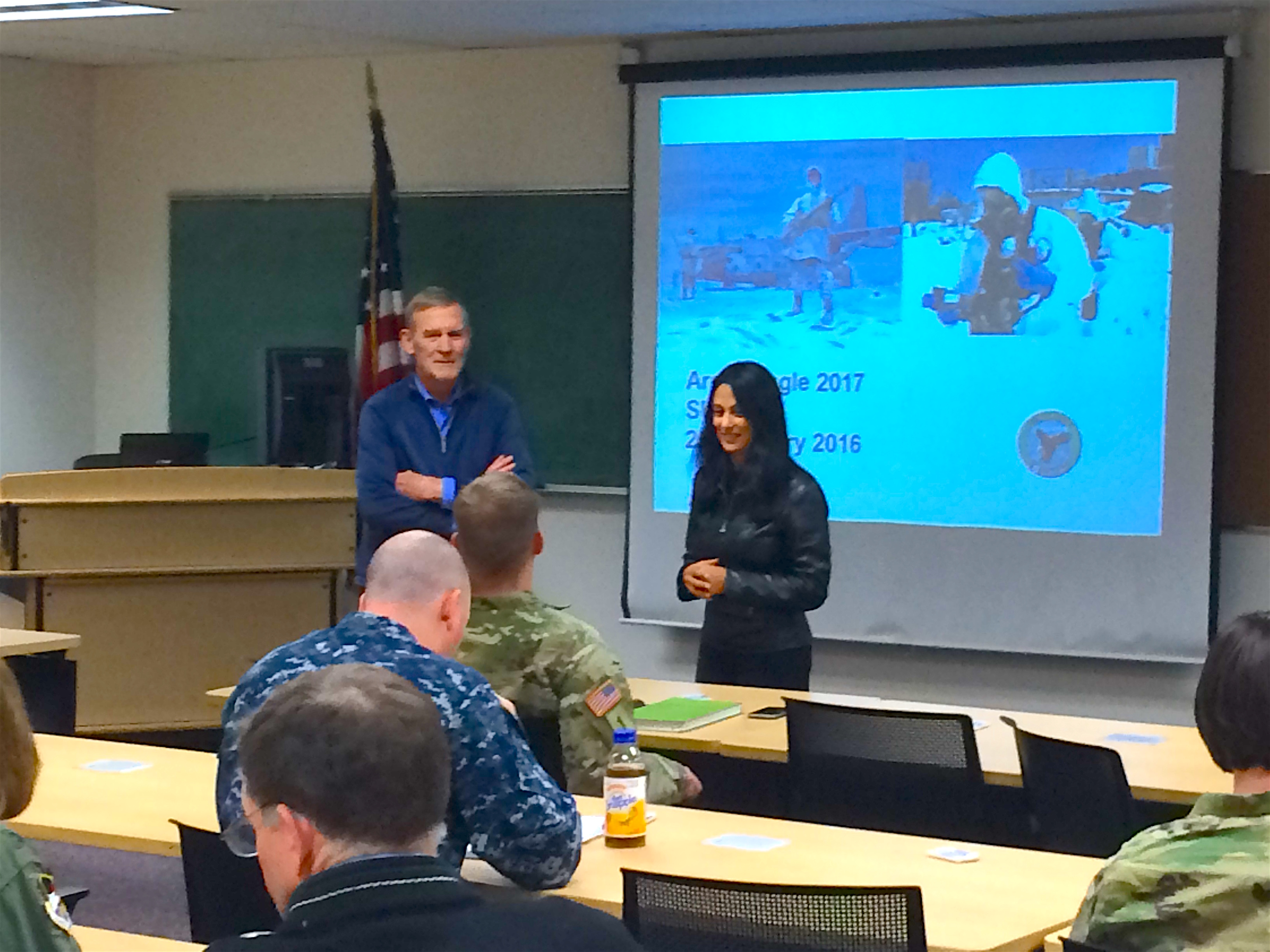 Tomasovic and Roy solicit feedback from the training audience during the exercise after-action review.