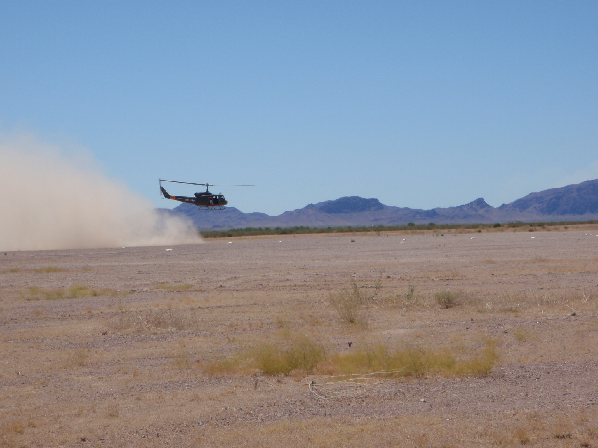 A helicopter lands on the dusty plains at Yuma Proving Grounds, AZ in an effort to better understand Helicopter Brownout