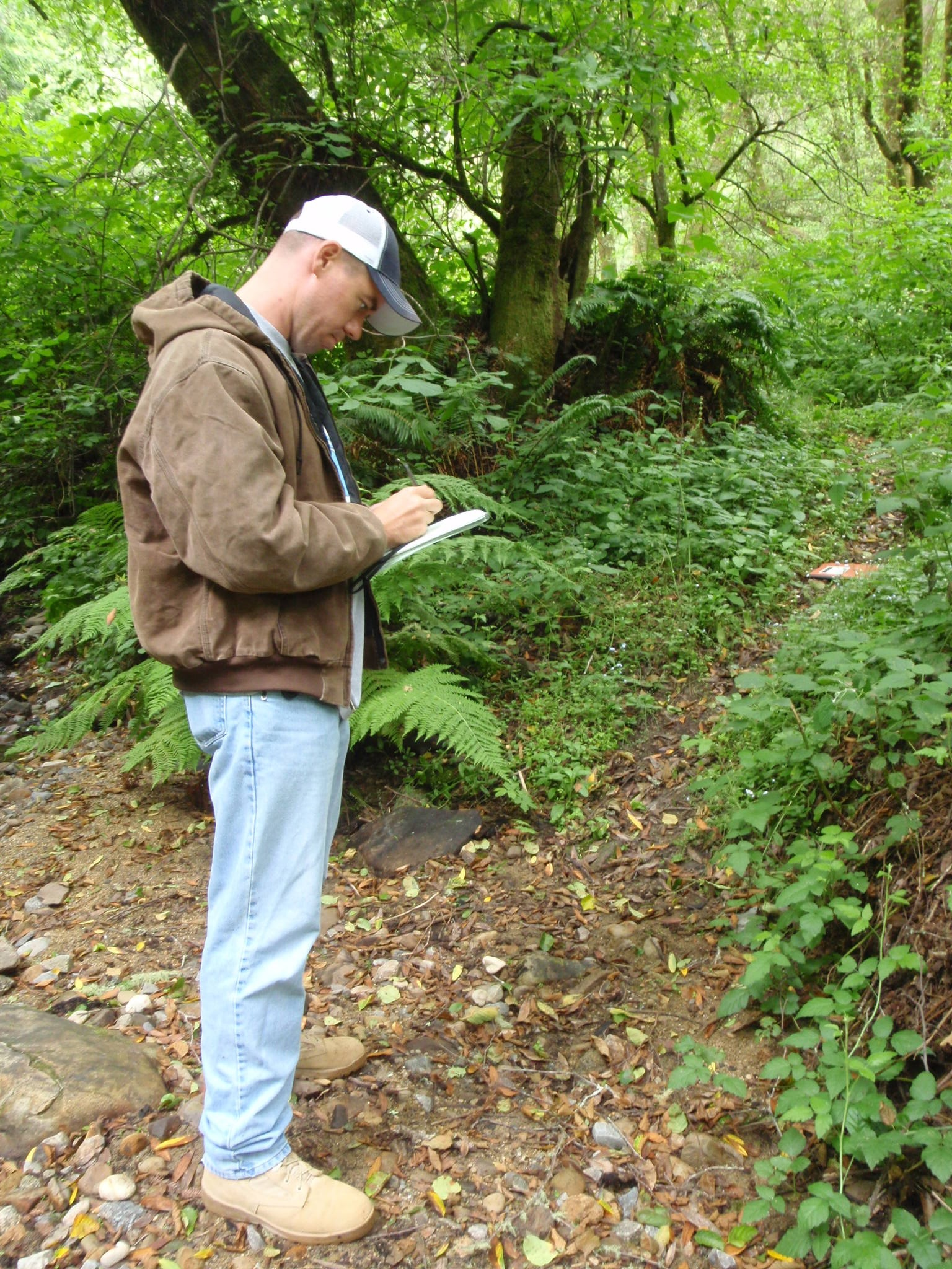 MAJ Frank Harmon takes field notes in the Santa Cruz Mountains, CA before collecting GPS data and LiDAR points
