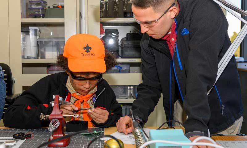 NPS Experts Help Boy Scout Troops Earn STEM-based Merit Badges During Campus Visit